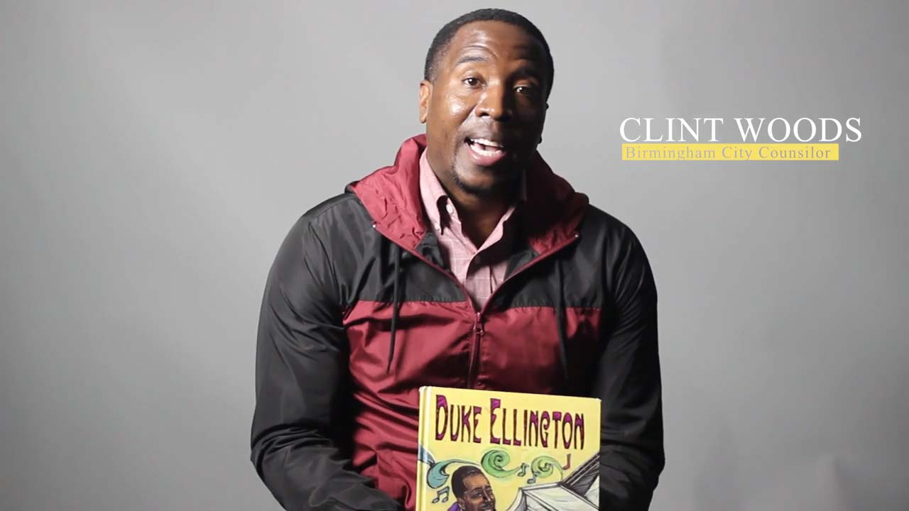 """Councilman Clinton Woods reads  """"Duke Ellington:  The Piano Prince""""  by Andrea Pinkney"""