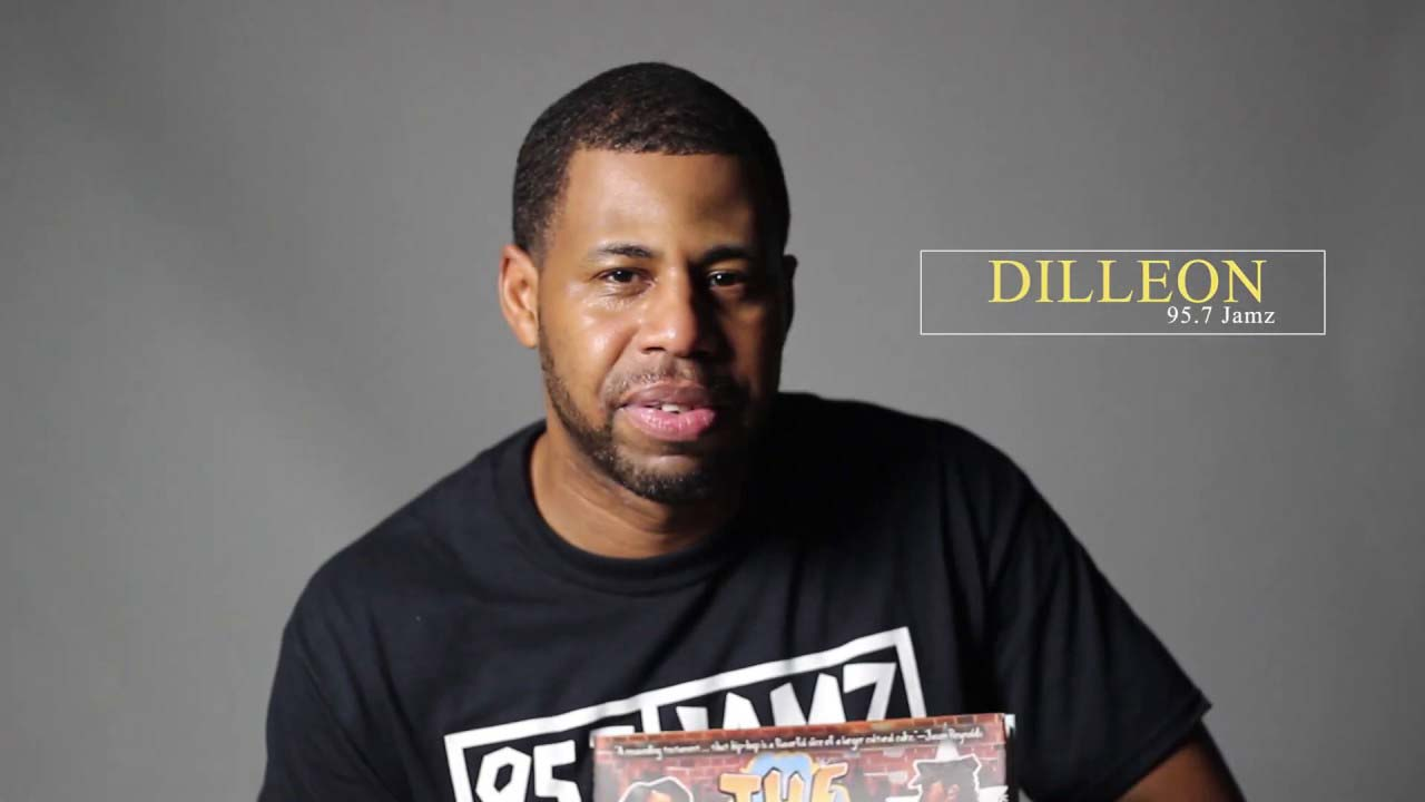 """Dilleon from 95.7 Jamz reads  """"The Roots of Rap""""  by Carole Boston Weatherford"""